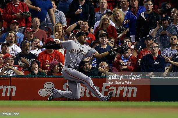 San Francisco Giants right fielder Justin Maxwell makes a catch for an out during the first inning of a baseball game against the St Louis Cardinals...