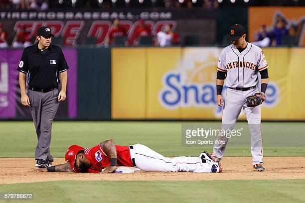 San Francisco Giants Second base Joe Panik [8959] looks down at Texas Rangers Designated hitter Prince Fielder [4699] after his head first slide...