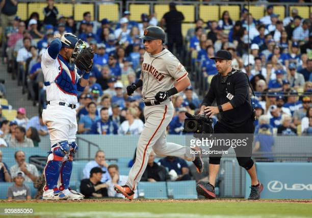 San Francisco Giants Second base Joe Panik rounds the bases after hitting for a solo home run during the MLB opening day game between the San...