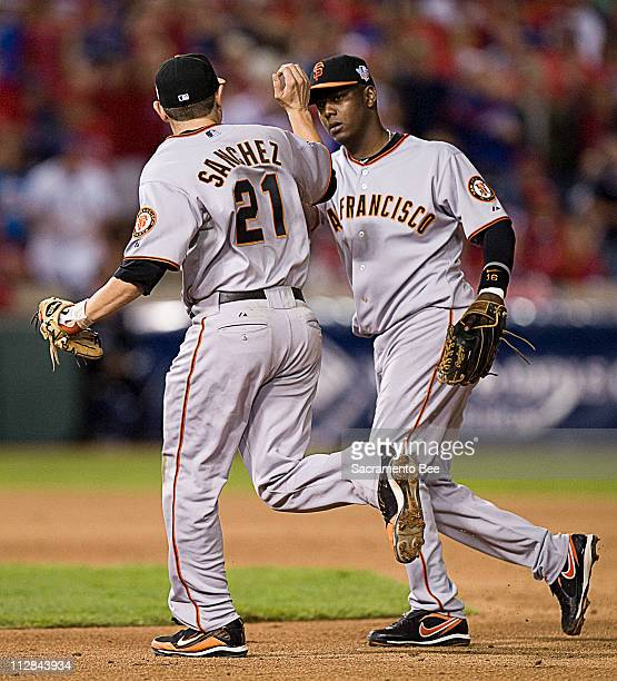 San Francisco Giants second baseman Freddy Sanchez and shortstop Edgar Renteria complete a double play that ended the sixth inning in Game 4 of the...