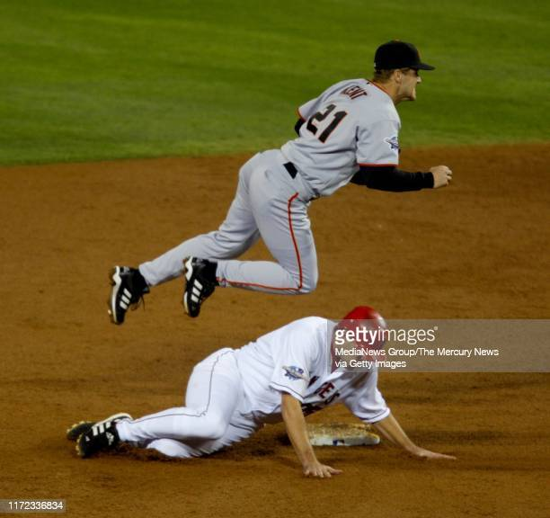 San Francisco Giants second baseman Jeff Kent gets Anaheim Angels Troy Glaus out in the third inning but can't make the throw in time to turn the...