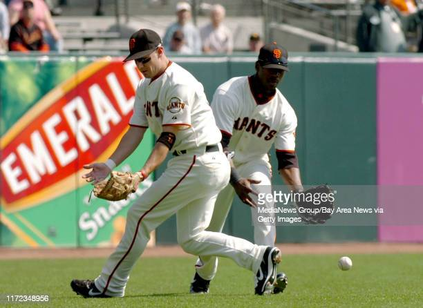 San Francisco Giants shortstop Kevin Frandsen errors in the first inning on an Arizona Diamondbacks' Conor Jackson popup as left fielder Fred Lewis...