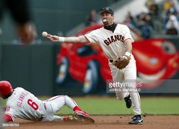 San Francisco Giants' shortstop Rich Aurilia relays to first base to complete a double-play while forcing out Philadelphia Phillies' Doug Glanville...