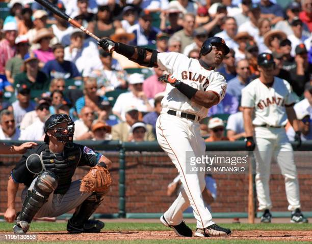 San Francisco Giants slugger Barry Bonds follows through with his 60th homerun of the season off Arizona Diamondbacks pitcher Albie Lopez during the...