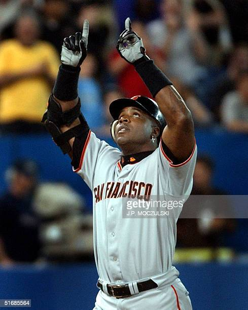 San Francisco Giants' slugger Barry Bonds gives thanks after hitting a home run off Toronto Blue Jay reliever Cliff Politte in ninth inning...