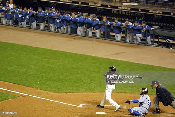 San Francisco Giants slugger Barry Bonds launches his record breaking 72 season homerun off Los Angeles Dodgers pitcher Chan Ho Park as Dodgers...