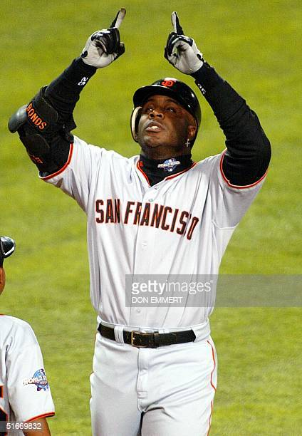 San Francisco Giants slugger Barry Bonds points to the sky after hitting a solo run homerun against the Anaheim Angels in the sixth inning of Game 6...
