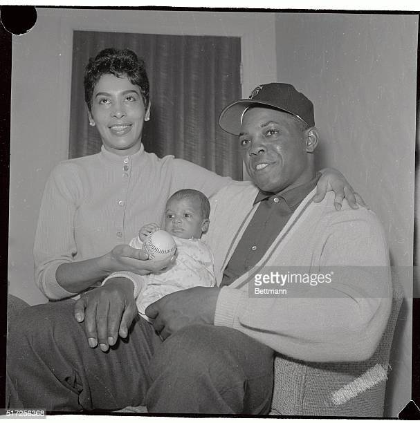 San Francisco Giant's slugger Willie Mays shows off for the first time his 5 week old adopted baby, Michael Rosiny, whom he and his wife, Marguerite,...