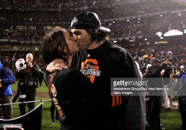 San Francisco Giants' starting pitcher Barry Zito gets a kiss from his wife Amber Seyer after they beat the St Louis Cardinals 90 to win Game 7 of...