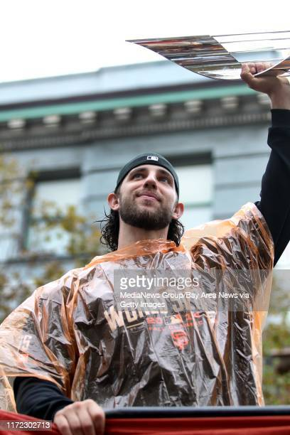 San Francisco Giants starting pitcher Madison Bumgarner holds up his World Series MVP trophy as acknowledges fans during the San Francisco Giants...