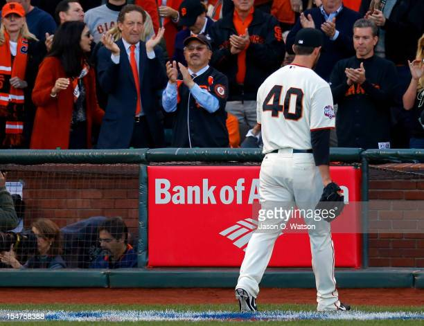 San Francisco Giants team owner Larry Baer and San Francisco Mayor Edwin M Lee cheer as Madison Bumgarner of the San Francisco Giants walks to the...