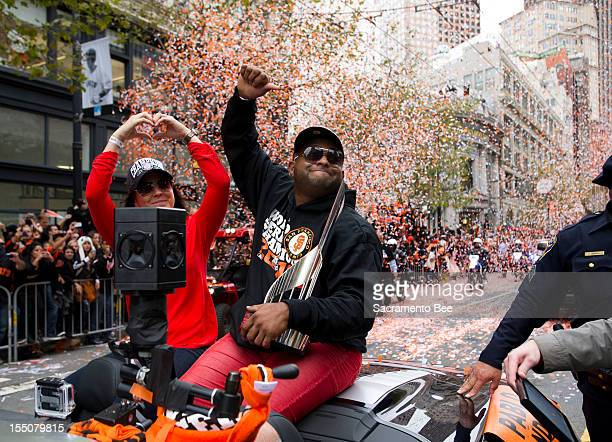 San Francisco Giants third baseman Pablo Sandoval waves to fans during a parade to celebrate the team's 2012 World Series Championship in downtown...