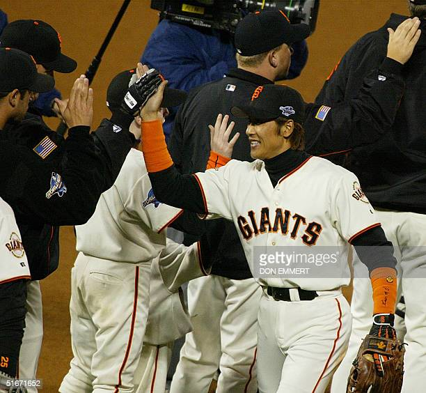 San Francisco Giants' Tsuyoshi Shinjo celebrates the Giants win with his temmates at the end of Game Five of the World Series in San Francisco 24...