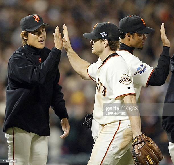 San Francisco Giants' Tsuyoshi Shinjo celebrates winning Game Four of the World Series with David Bell 23 October 2002 The Giants won the game 43 to...