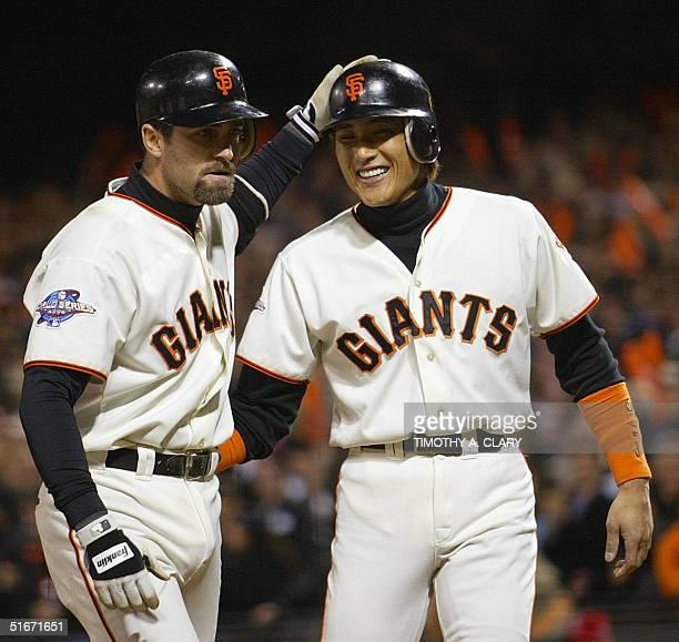 San Francisco Giants' Tsuyoshi Shinjo congratulates Rich Aurilia after Aurilia hit a threerun home run in the eighth inning of Game Five of the World...