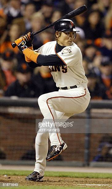 San Francisco Giants' Tsuyoshi Shinjo prepares to swing at the ball against the Anaheim Angels in the sixth inning in Game Five in the World Series...