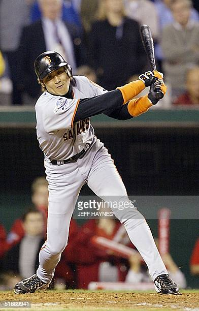 San Francisco Giants' Tsuyoshi Shinjo strikes out swinging in the ninth inning of Game Seven of the World Series against the Anaheim Angels 27...