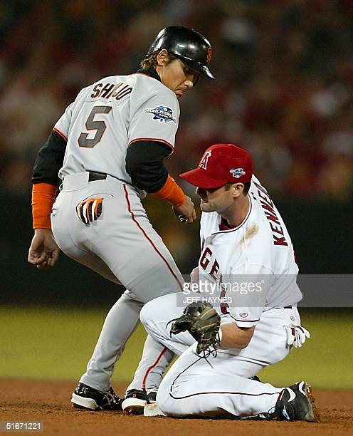 San Francisco Giants' Tsuyoshi Shinjo tags up as Anaheim Angels' Adam Kennedy attempts to pick him off during the fifth inning of Game One of the...