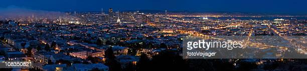 San Francisco glittering lights downtown illuminated blue dusk panorama California