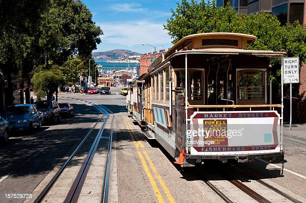 san francisco historic cable car overlooking bay pier alcatraz island - overhead cable car stock pictures, royalty-free photos & images