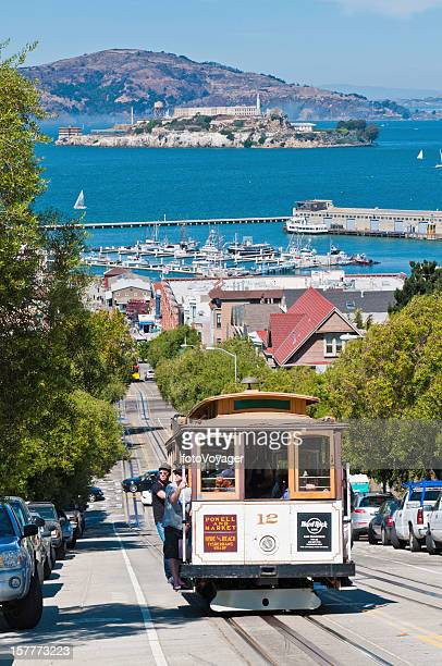 san francisco iconic cable car with tourists california usa - alcatraz stock photos and pictures