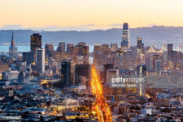 san francisco illuminated skyline at dusk, caslifornia - san francisco california stock pictures, royalty-free photos & images