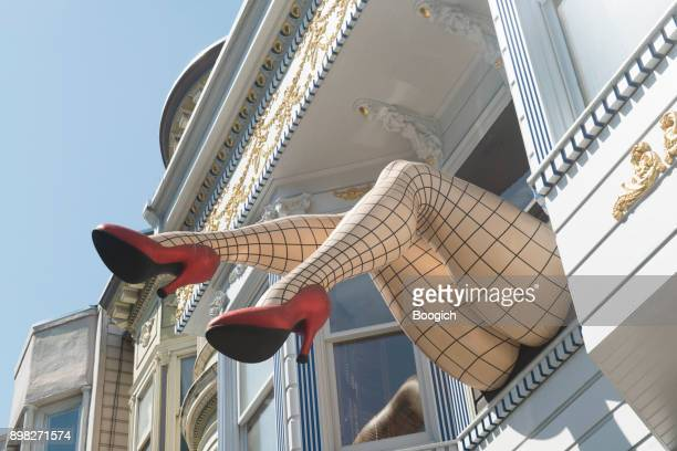 san francisco landmark giant high heeled legs wearing fishnets haight - haight ashbury stock photos and pictures