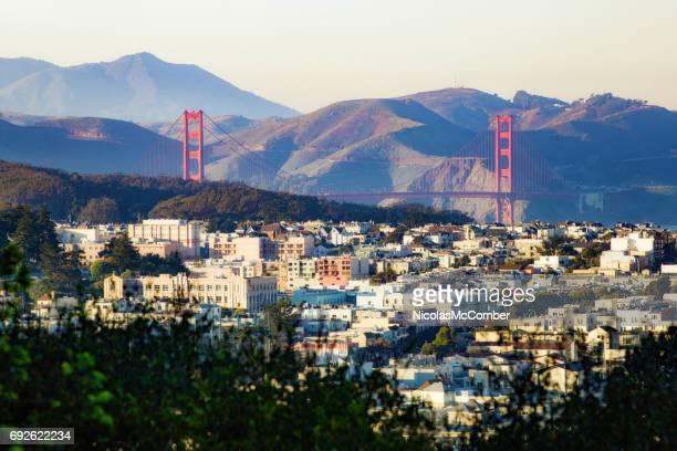san francisco laurel and presidio heights panorama at sunset with golden gate bridge - san francisco california stock photos and pictures