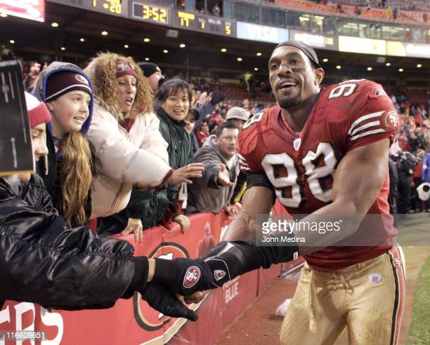 San Francisco linebacker Julian Peterson is congratulated by fans after the 49ers 2017 overtime defeat of the Houston Texans January 1 2006 at...