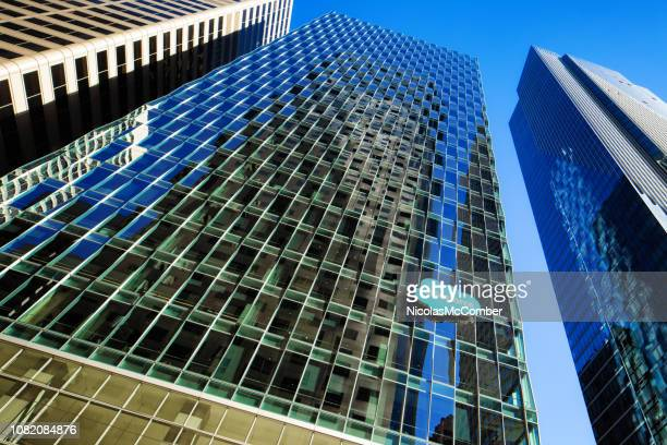 San Francisco Low Angle view of glass Salesforce office tower with reflections