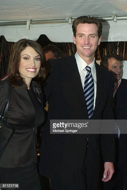 San Francisco Mayor Gavin Newsom and his wife Kimberly Guilfoyle Newsom attend the GQ party in his honor July 27 2004 at The Federalist Restaurant in...
