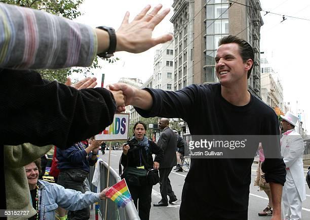 San Francisco Mayor Gavin Newsom greets spectators at the 2005 San Francisco Pride Parade June 26, 2005 in San Francisco, California. Tens of...