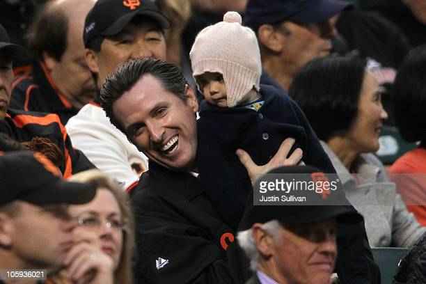 San Francisco Mayor Gavin Newsom holds his daughter Montana Tessa Newsom in the stands during Game Five of the NLCS during the 2010 MLB Playoffs...
