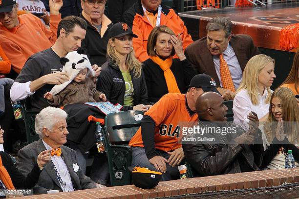 San Francisco Mayor Gavin Newsom sits with his wife Jennifer Siebel daughter Montana and US Speaker of the House Rep Nancy Pelosi during Game One of...