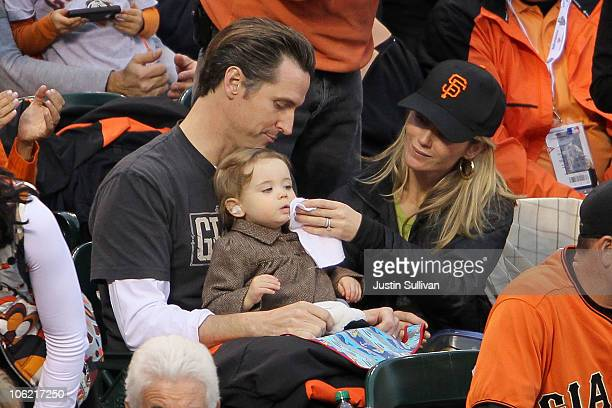 San Francisco Mayor Gavin Newsom sits with his wife Jennifer Siebel and daughter Montana during Game One of the 2010 MLB World Series at ATT Park on...