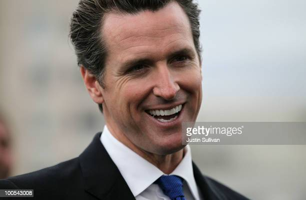 San Francisco mayor Gavin Newsom smiles during a news conference May 25 2010 in San Francisco California Mayor Newsom signed fee deferment...