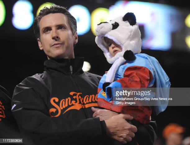 San Francisco mayor Gavin Newsom stands with his daughter Montana Newsom while watching the San Francisco Giants play the Philadelphia Phillies in...