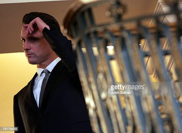 San Francisco Mayor Gavin Newsom wipes his forehead during a swearing in ceremony for San Francisco City assessor Phil Ting February 1 2007 in San...