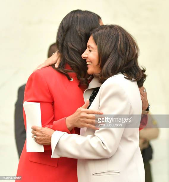 San Francisco Mayor London Breed hugs Paris Mayor Anne Hidalgo during the C40 Cities For Climate The Future Is Us kickoff event at San Francisco's...