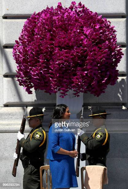 San Francisco mayor London Breed looks on as San Francisco Sheriff deputy honor guard pass by during her inauguration at San Francisco City Hall on...