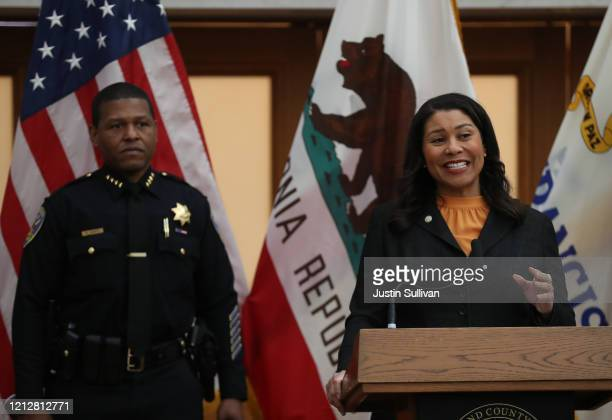 San Francisco Mayor London Breed speaks during a press conference as San Francisco police chief William Scott looks on at San Francisco City Hall on...