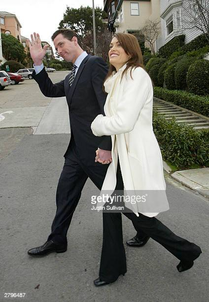San Francisco mayoral candidate Gavin Newsom and his wife Kimberly GuilfoyleNewsom walk home after they cast their ballots for the mayoral runoff...