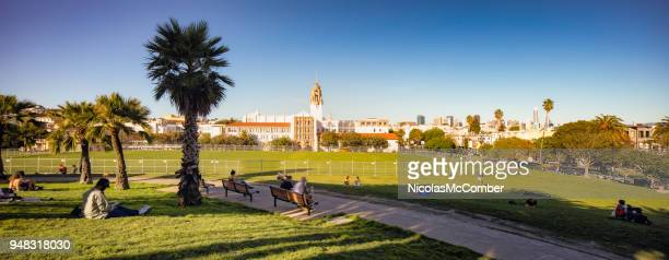 san francisco mission dolores park panoramic view - mission district stock photos and pictures