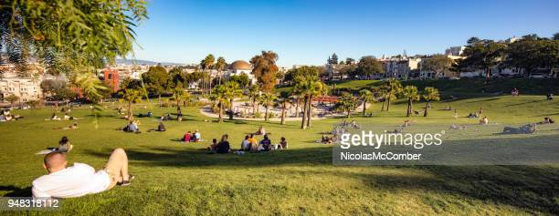san francisco mission dolores public park panoramic view - mission district stock photos and pictures