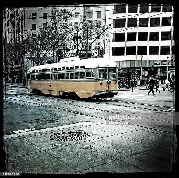 A San Francisco Muni electric trolley car makes its way through downtown San Francisco on Market Street