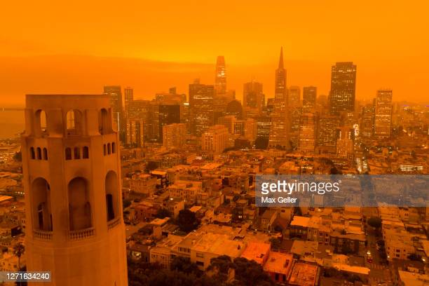 san francisco orange sky during fire season - california stock pictures, royalty-free photos & images