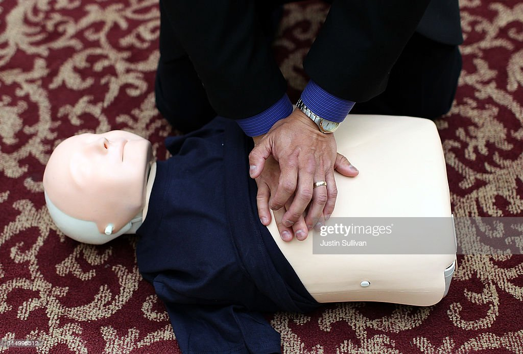San Francisco Paramedic Association CEO Art Hsieh demonstrates how to perform CPR compressions using a mannequin on June 1, 2011 in San Francisco, California. The San Francisco Paramedic Association and the American Heart Association kicked off National CPR Week by offering free CPR training to the public.