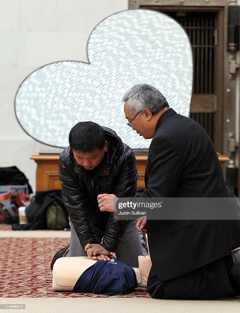 San Francisco Paramedic Association CEO Art Hsieh (R) teaches a man how to perform CPR using a mannequin on June 1, 2011 in San Francisco, California. The San Francisco Paramedic Association and the American Heart Association kicked off National CPR Week by offering free CPR training to the public.