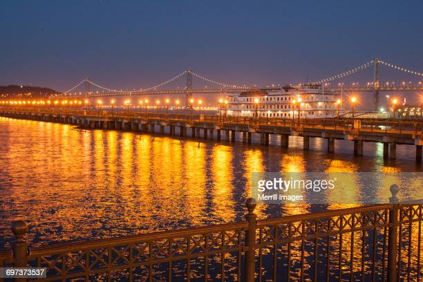 san francisco pier in evening - oakland california stock pictures, royalty-free photos & images