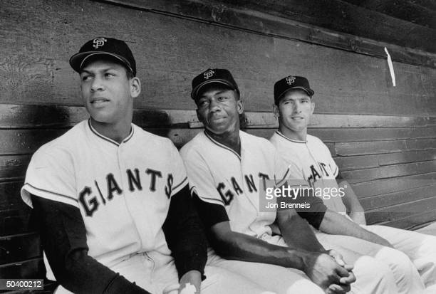San Francisco players Orlando Cepeda Willie Kirkland and Jimmy Davenport sitting in the dugout of the GiantsBraves game